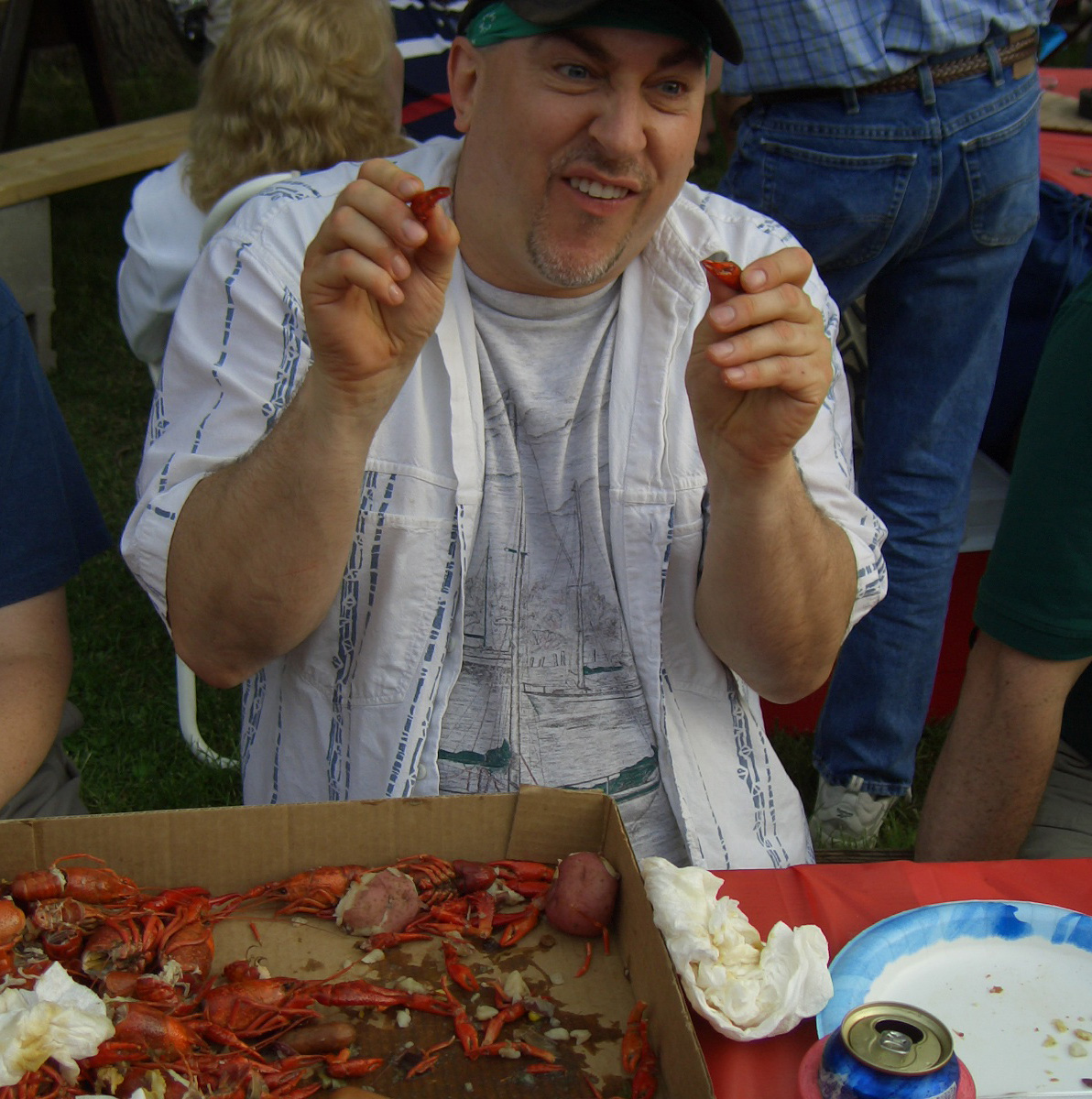 Paul playing with crayfish claws at boil in Troy, Missouri